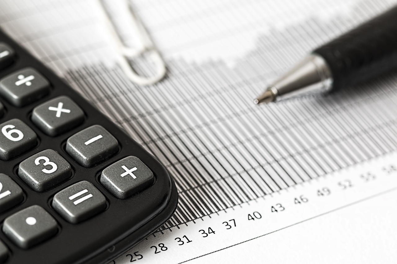 Recording tax with calculator and pen